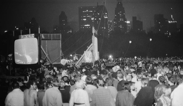 A crowd watches in Central Park, New York City, as the Apollo 11 crew lands on the moon on July 20, 1969.