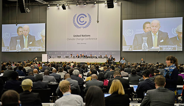 French Foreign Minister Laurent Fabius talks to delegates during the U.N. Framework Convention on Climate Change in Bonn, Germany, June 1, 2015.