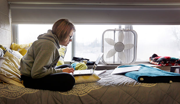 A college student studies in her dorm, December 2014.