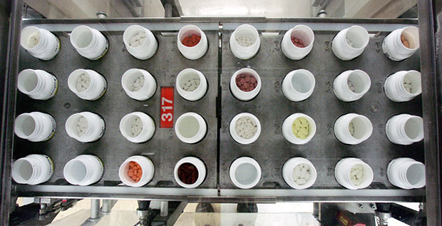 Bottles of prescription medications move along a production line at a dispensing pharmacy, February 2006.