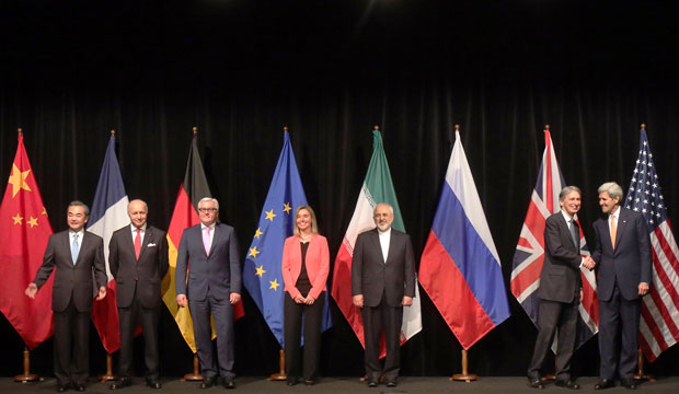 Negotiators pose for a group photo following talks with Iran on its nuclear program in Vienna, Austria, on July 14, 2015.