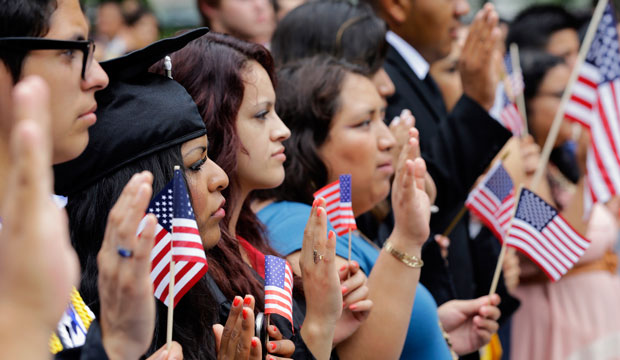 DREAMers and parents take an oath in a mock citizenship ceremony in Washington, D.C., on July 10, 2013.