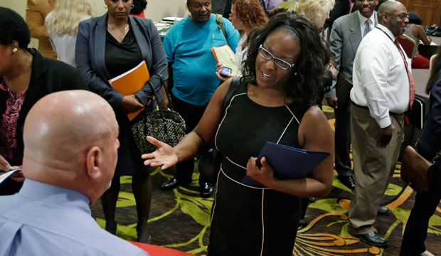 Marsha Lawson talks with a potential employer at the Cleveland Career Fair in Independence, Ohio, on June 12, 2014.