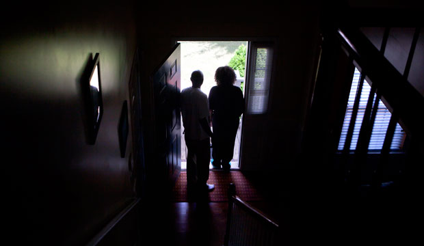 Michael and Patricia Jackson stand in the doorway of a home they are struggling to keep on June 16, 2012, in Marietta, Georgia.