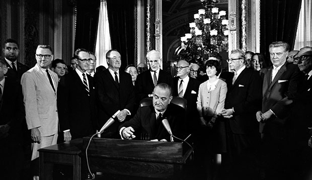 President Lyndon B. Johnson signs the Voting Rights Act of 1965 in a ceremony in the President's Room near the Senate Chambers on Capitol Hill in Washington, August 6, 1965.