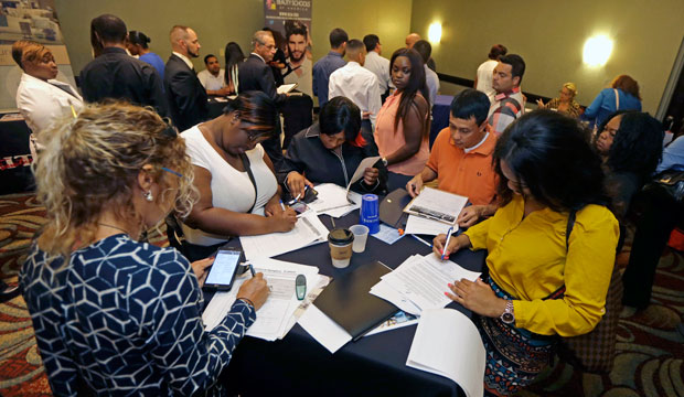 Job seekers attend a job fair in Miami Lakes, Florida, July 2015.