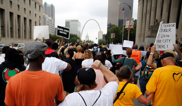 Protesters march to the Thomas F. Eagleton Federal Courthouse on August 10, 2015, in St. Louis, Missouri.