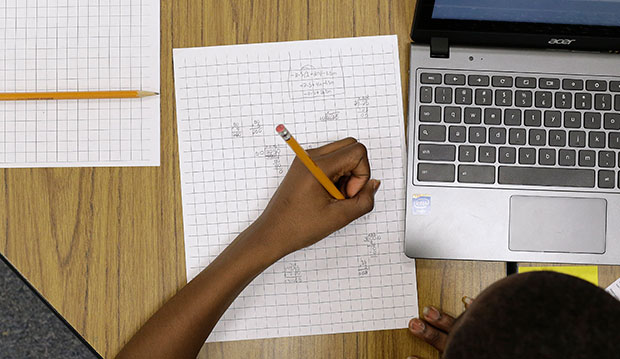 A 12-year-old student works on math problems as part of a trial run of a new state assessment test in Annapolis, Maryland, February 12, 2015.