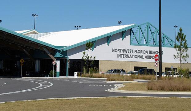 Passengers wait outside the Northwest Florida Beaches International Airport in Panama City, Florida, December 2010.