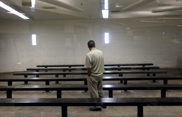 A man waits to be processed at a Border Patrol detention center in Imperial Beach, California, in January 2012.