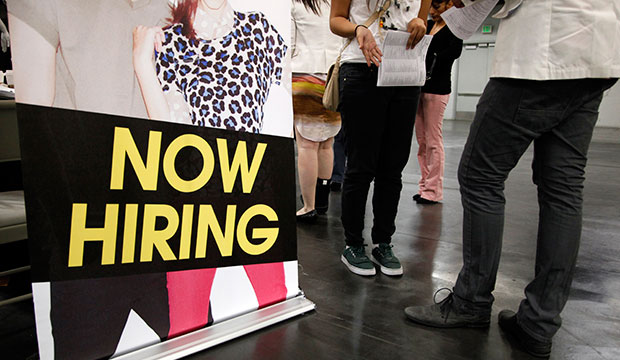 A job seeker talks to a recruiter at a job fair expo in Anaheim, California, June 2012.