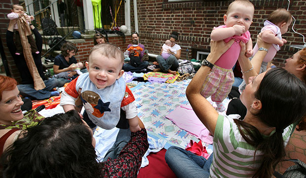 Parents and their babies enjoy a music appreciation and therapy lesson for infants in 2008.