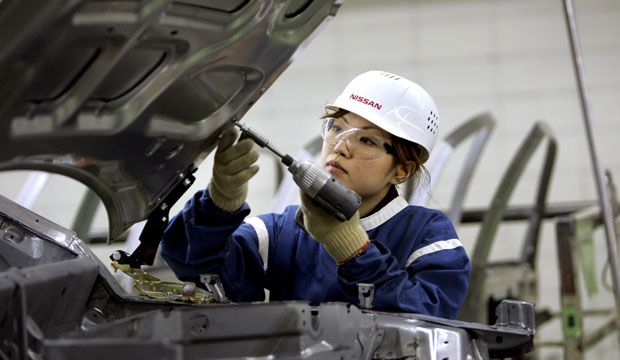 A worker screws a bolt into the hood at a car body manufacturing plant in Tochigi Prefecture, Japan, in 2007.