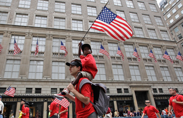 Duke Scoppa marches up Fifth Ave with his son during the Labor Parade, September 10, 2011, in New York.