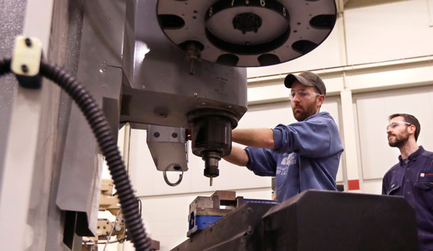 Brad Bancroft operates a mill during Lansing Community College's advanced precision machining class on February 11, 2015.