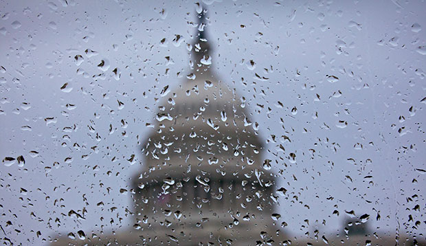 Wet weather blows into Capitol Hill in Washington, Wednesday, November 27, 2013.