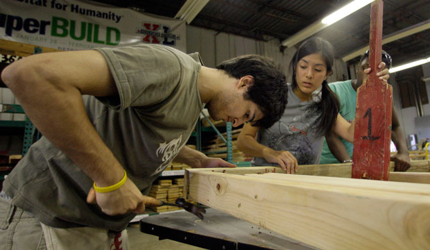 Rice University students work to assemble frames at the Habitat for Humanity warehouse in Houston, Texas, July 2009.