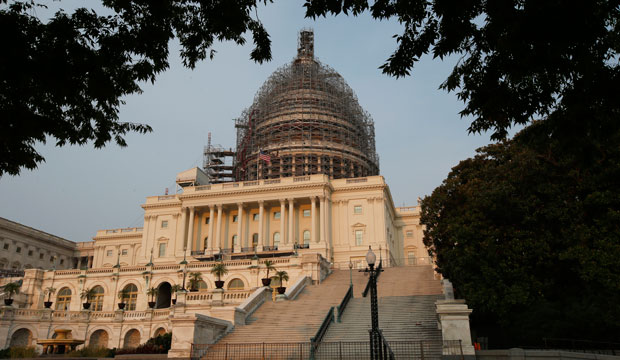 The U.S. Capitol is seen under repair in Washington, D.C., September 2015.