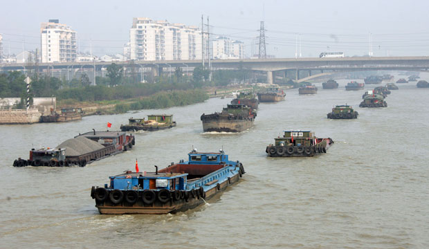 Barges navigate on the Grand Canal in China, plying a trade route built 2,500 years ago, October 2010.