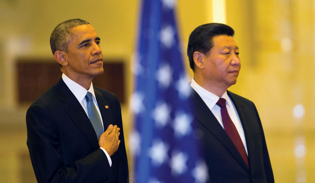 U.S. President Barack Obama stands with Chinese President Xi Jinping as the U.S. national anthem is played during a welcome ceremony in Beijing on November 12, 2014.