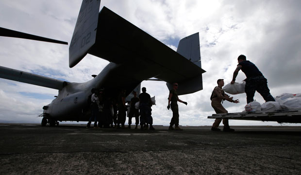 At Tacloban airport in the central Philippines, U.S. troops load relief supplies to a U.S. Marine MV-22 Osprey aircraft for airdrop to typhoon-ravaged remote places in 2013.