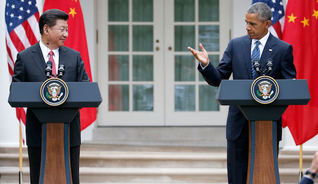 President Barack Obama gestures toward Chinese President Xi Jinping during a news conference at the White House on September 25, 2015.