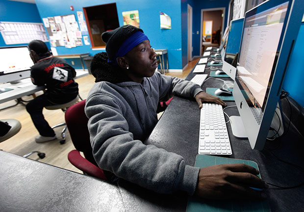 A young adult uses a computer at the Ruth Ellis Center, a drop-in shelter for LGBT youth in Detroit, March 2012.