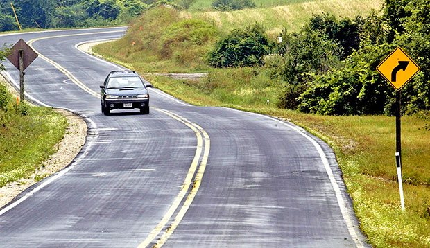 A car drives along County Highway A near Elkhart Lake, Wisconsin, July 2004.
