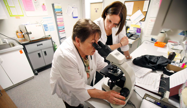 Nurse practitioner Sharon Spiller and physician assistant Tiernie Garbers work in a lab in Cedar Rapids, Iowa, in 2009.
