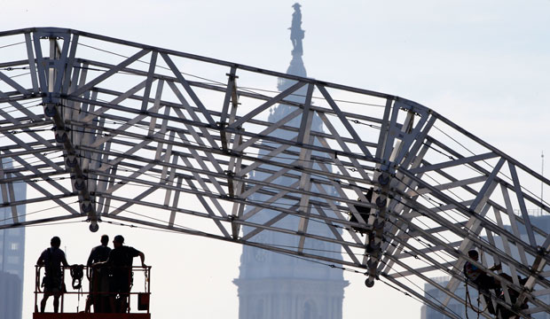 Workers build a stage ahead of Pope Francis' visit on September 17, 2015, in view of the Philadelphia City Hall.
