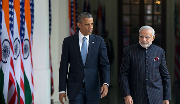 President Barack Obama walks with Indian Prime Minister Narendra Modi to be photographed by media at the Hyderabad House in New Delhi, January 25, 2015.