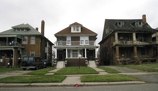 Pictured is a street scene in Detroit, where it's not uncommon to find dilapidated homes side by side with occupied homes, December 2014.