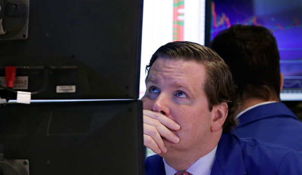 Specialist Gregg Maloney works at his post on the floor of the New York Stock Exchange on October 13, 2015.