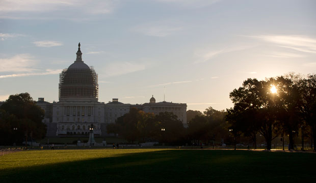 The sun rises behind the U.S. Capitol grounds in Washington, D.C., October 2014.