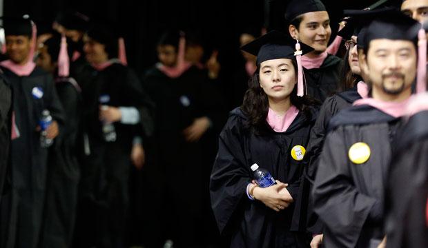 Graduates line up before commencement ceremonies.