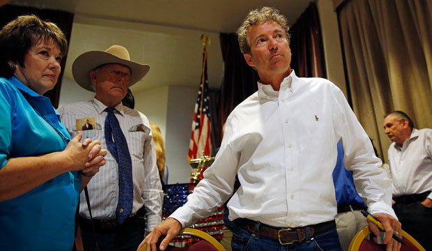 Sen. Rand Paul (R-KY) stands with Carol and Cliven Bundy on June 29, 2015, in Mesquite, Nevada.