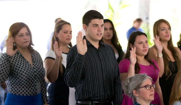 New citizens take the Oath of Allegiance during a U.S. Citizenship and Immigration Services naturalization ceremony in July, 2015.