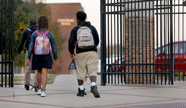 Students arrive for class at a St. Louis high school, October 22, 2015.