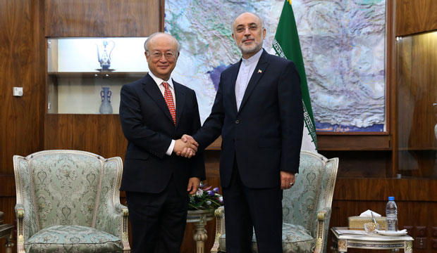 Head of Iran's Atomic Energy Organization Ali Akbar Salehi, right, and International Atomic Energy Agency Director General Yukiya Amano meet in Tehran on September 20, 2015.