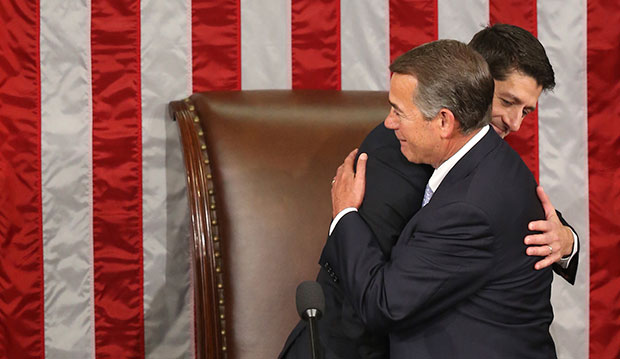 Outgoing House Speaker John Boehner (R-OH) hugs his successor, Rep. Paul Ryan (R-WI), in the House Chamber on Capitol Hill in Washington, October 29, 2015.