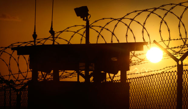 The sun rises above Camp Delta at Guantanamo Bay Naval Base, Cuba, on November 20, 2013.