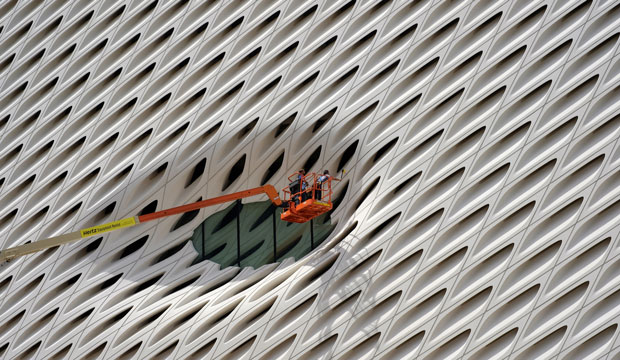 Workers clean the facade of the Broad Museum in downtown Los Angeles on September 1, 2015.