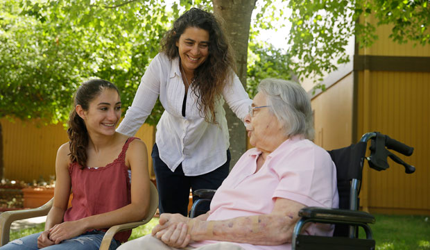 Kamila Al-Najjar, center, visits with her mother, Joan Groen, right, along with her daughter, Inanna Al-Najjar, left, at an assisted living facility in Santa Rosa, California, on July 6, 2015.