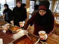 Muslim volunteers at soup kitchen