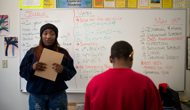 In this May 18, 2015 photo, Bre'Ana Henderson, 17, left, speaks in a classroom in Los Angeles.