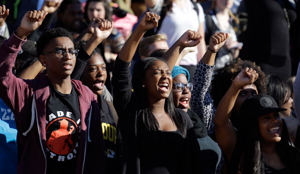 Students cheer following the resignation of University of Missouri system President Tim Wolfe in Columbia, Missouri, on November 9, 2015.