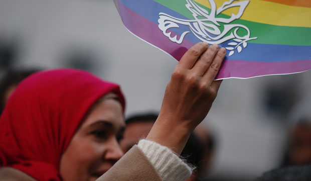 A Muslim woman holds up a peace flag in Milan, Italy, during a protest against violence on November 21, 2015.