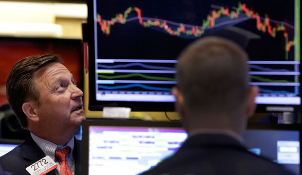 Specialist Thomas Facchine works on the floor of the New York Stock Exchange on September 1, 2015.