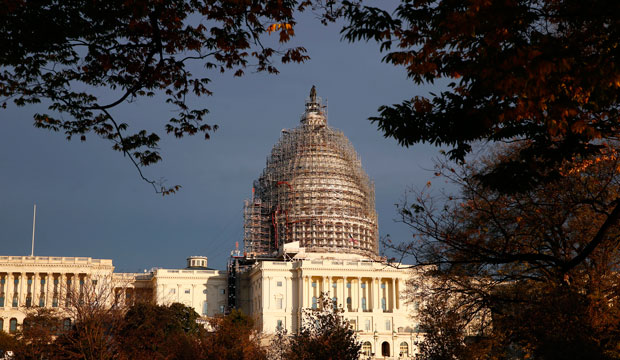 The U.S. Capitol dome is seen under repair on Capitol Hill, Sunday, November 22, 2015 in Washington.