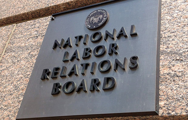 The sign for the National Labor Relations Board is seen on the building that houses its headquarters in downtown Washington, July 17, 2013.